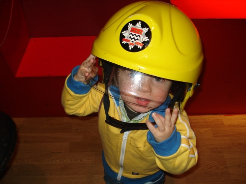 Dickon in fireman's helmet